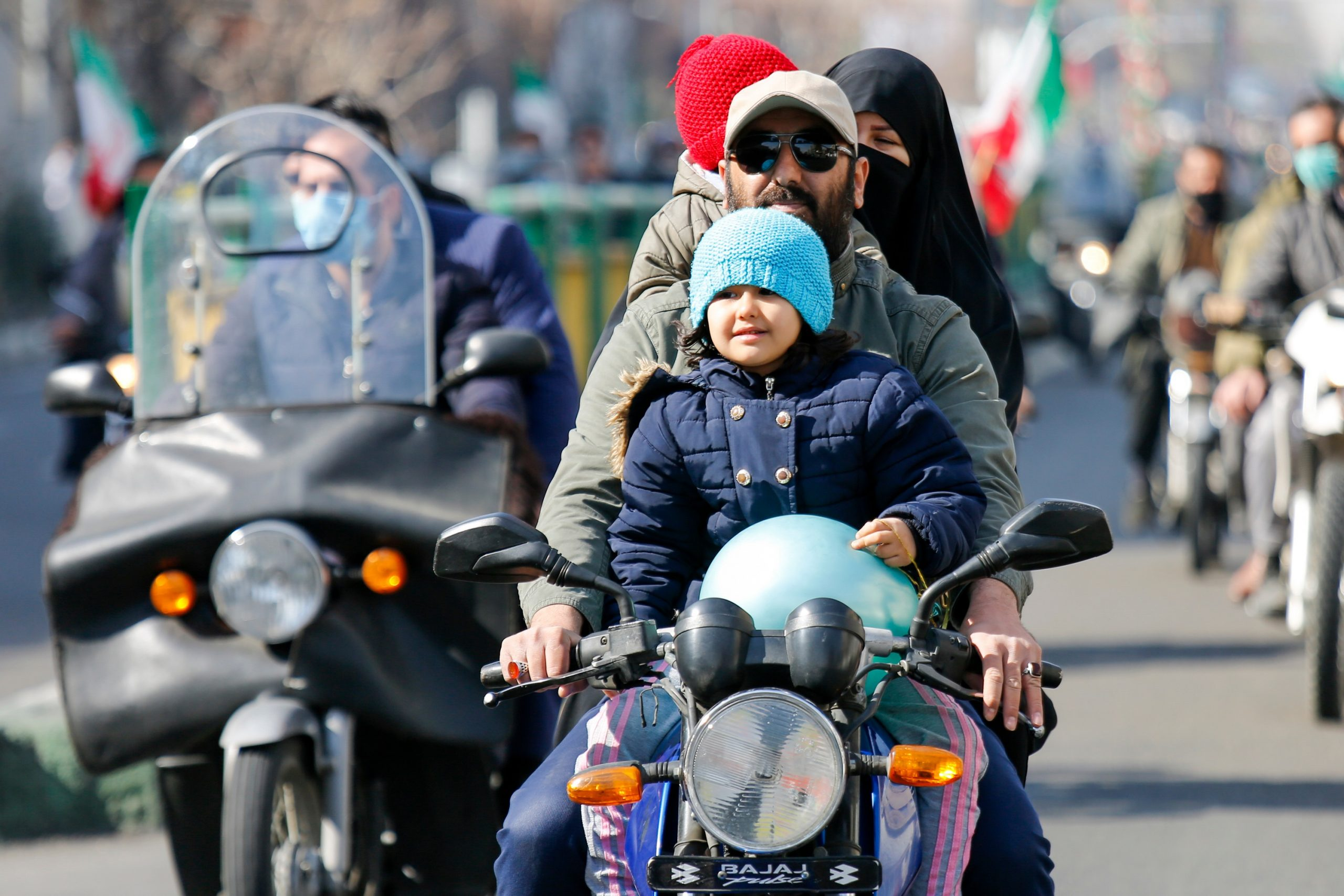 Tehran, Iran - February 10, 2021 -People took part in the drive-in rallies on their motorcycles amid the pandemic to commemorate the 42nd victory of the Islamic Revolution in 1979.